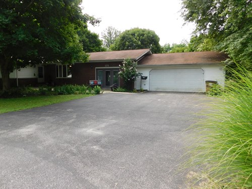 Great 3 BR 2.5 Bath brick ranch on over 1/2 acre.