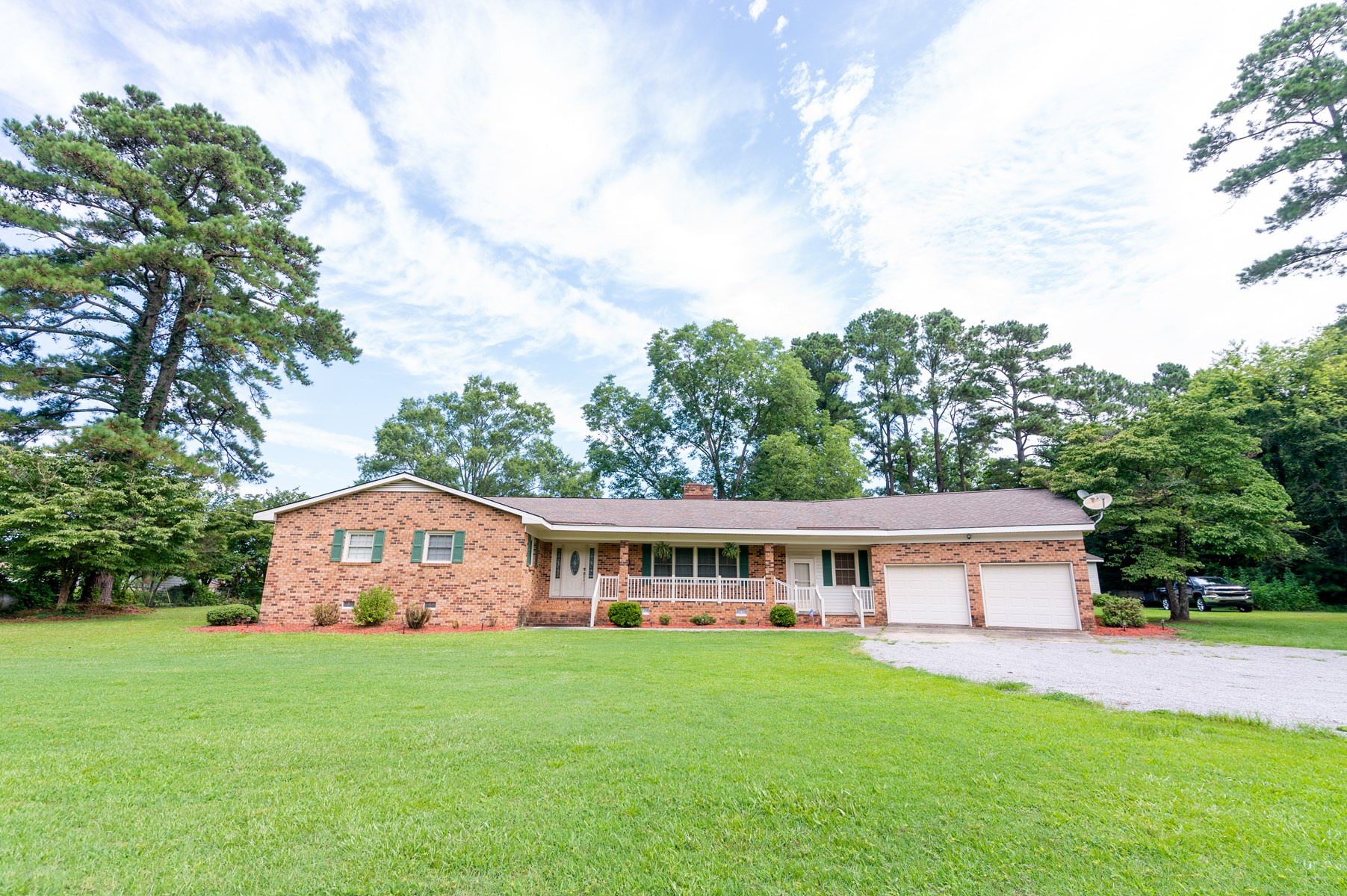Brick rancher on a 1 acre lot