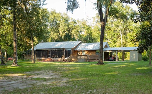 Rustic wood home on 9.19 Acres with a creek!