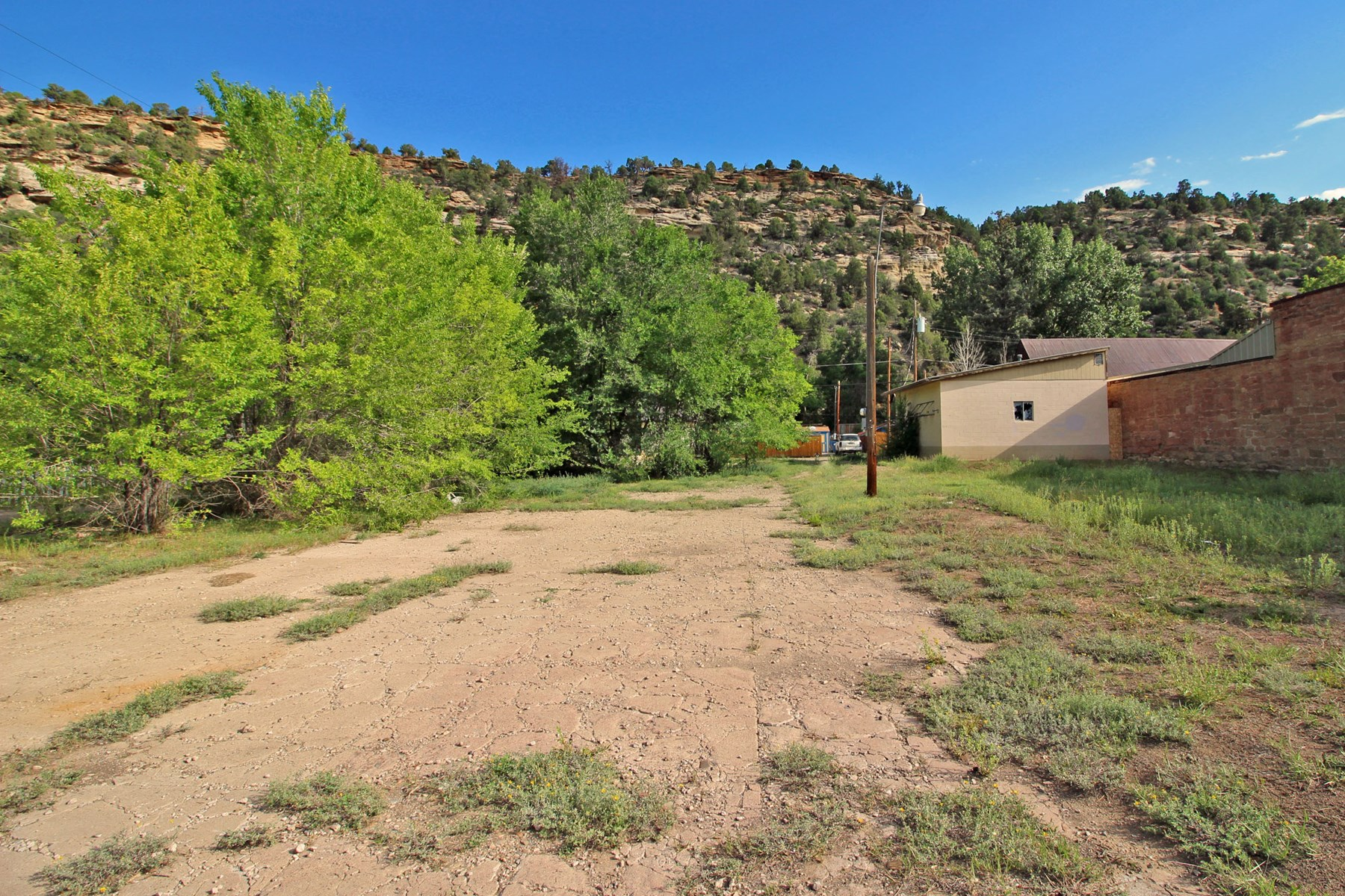 Commercial land with garage for sale in Dolores, Colorado.