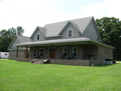 LUXURY 4 BEDROOM BRICK HOME WITH ACREAGE IN ADAMSVILLE, TN