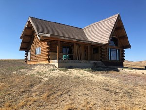UNFINISHED COLORADO LOG HOME FOR SALE ON ACREAGE WATER
