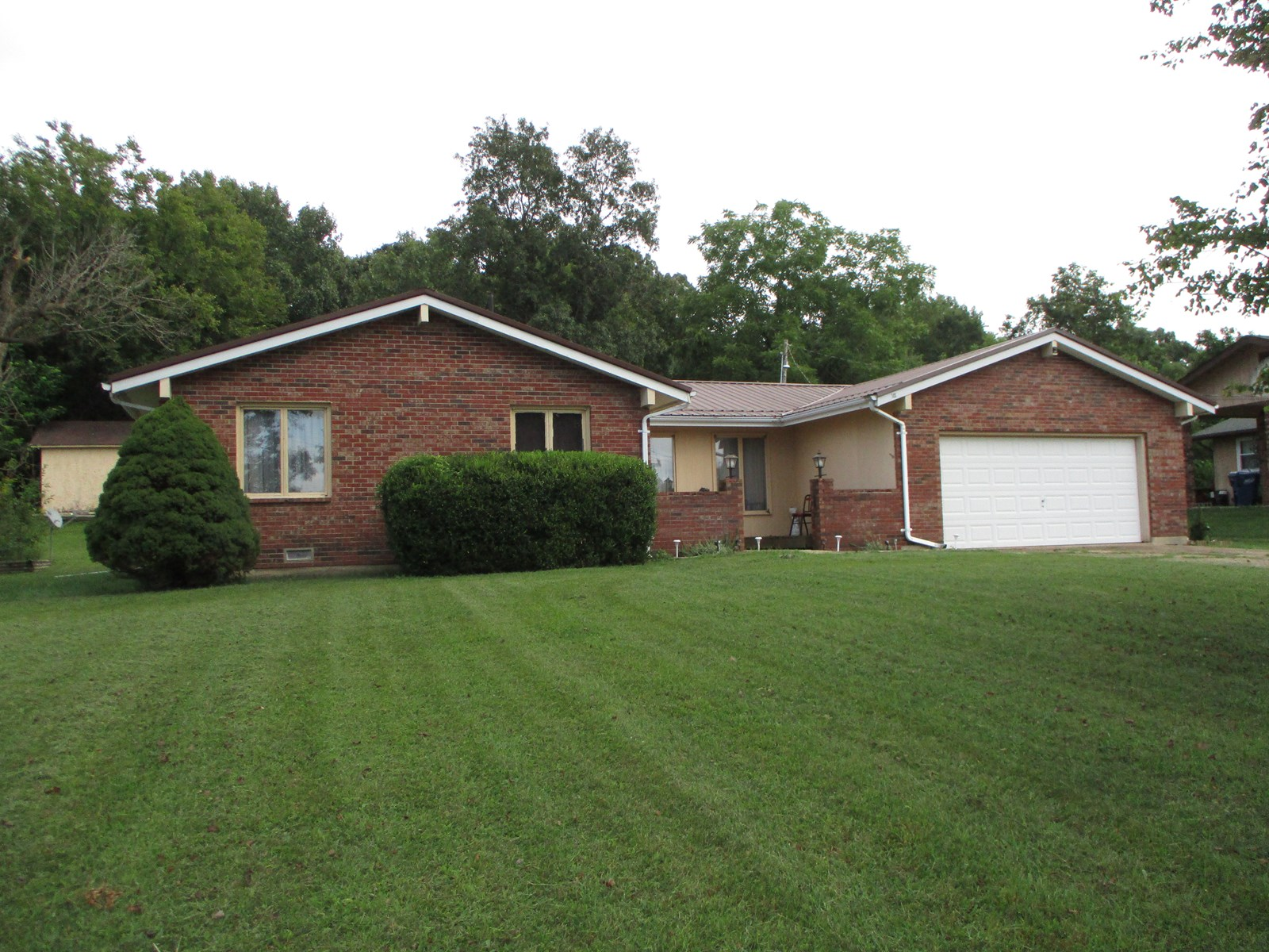 3 bedroom home, close to high school. Large yard with garage