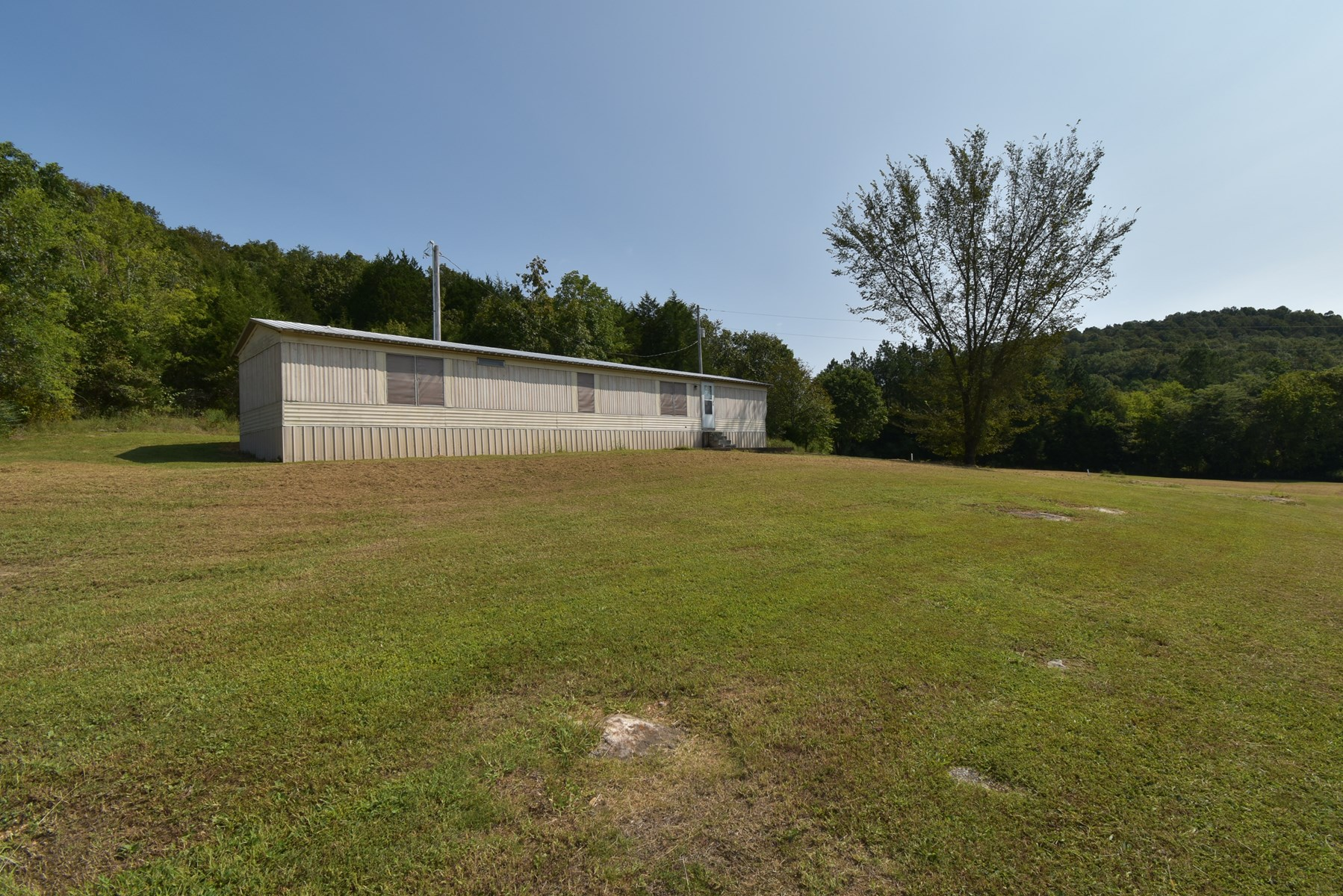 22 acres and a manufactured home for sale!
