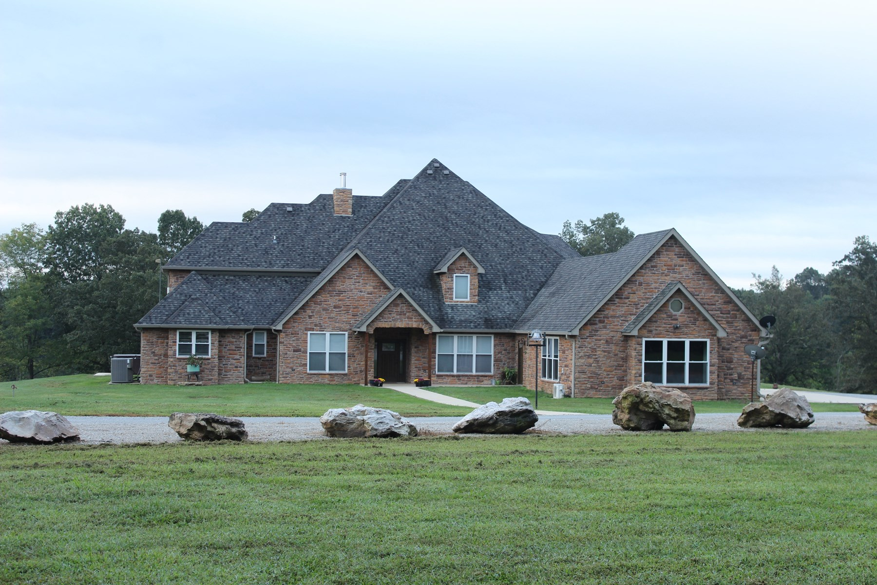 Executive-Style Stone Home with Acreage for Sale
