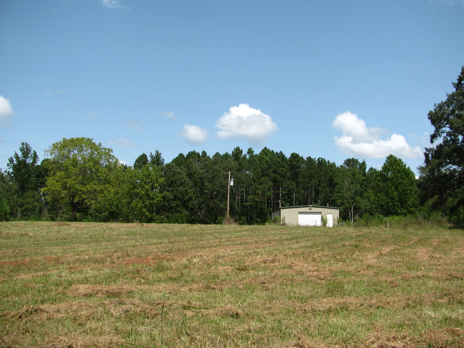 LAND FOR SALE WITH SHOP, POND, FENCING, WOODS, NEAR TN RIVER