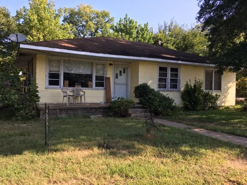 HOME IN TOWN ON CORNER LOT! POSSIBLE 3RD BEDROOM!