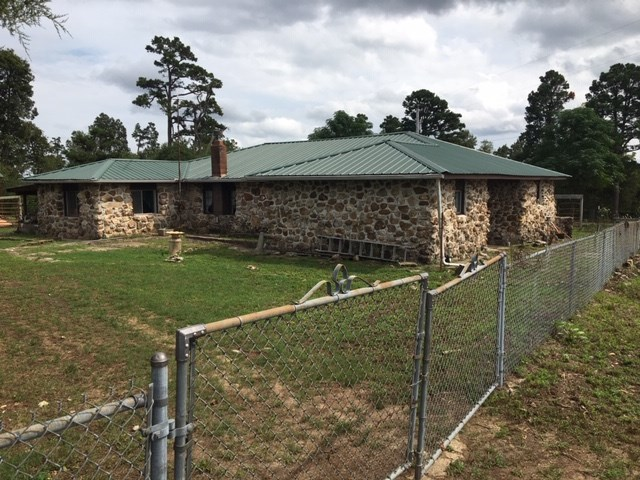 NICE OLDER ROCK HOUSE ON 1/2 ACRE LOT JUST OFF PAVED ROAD