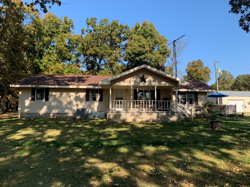 Quiet Country Home Near City Limits with Small Acreage