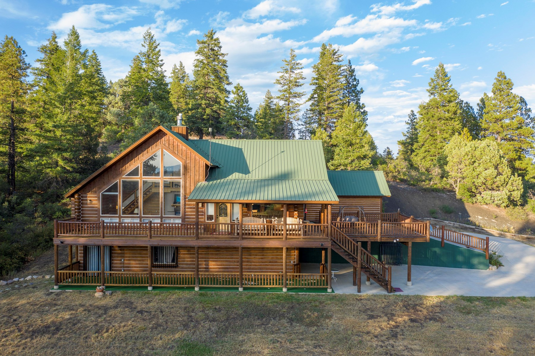 Log House bordered by forest service in Pagosa Springs, CO