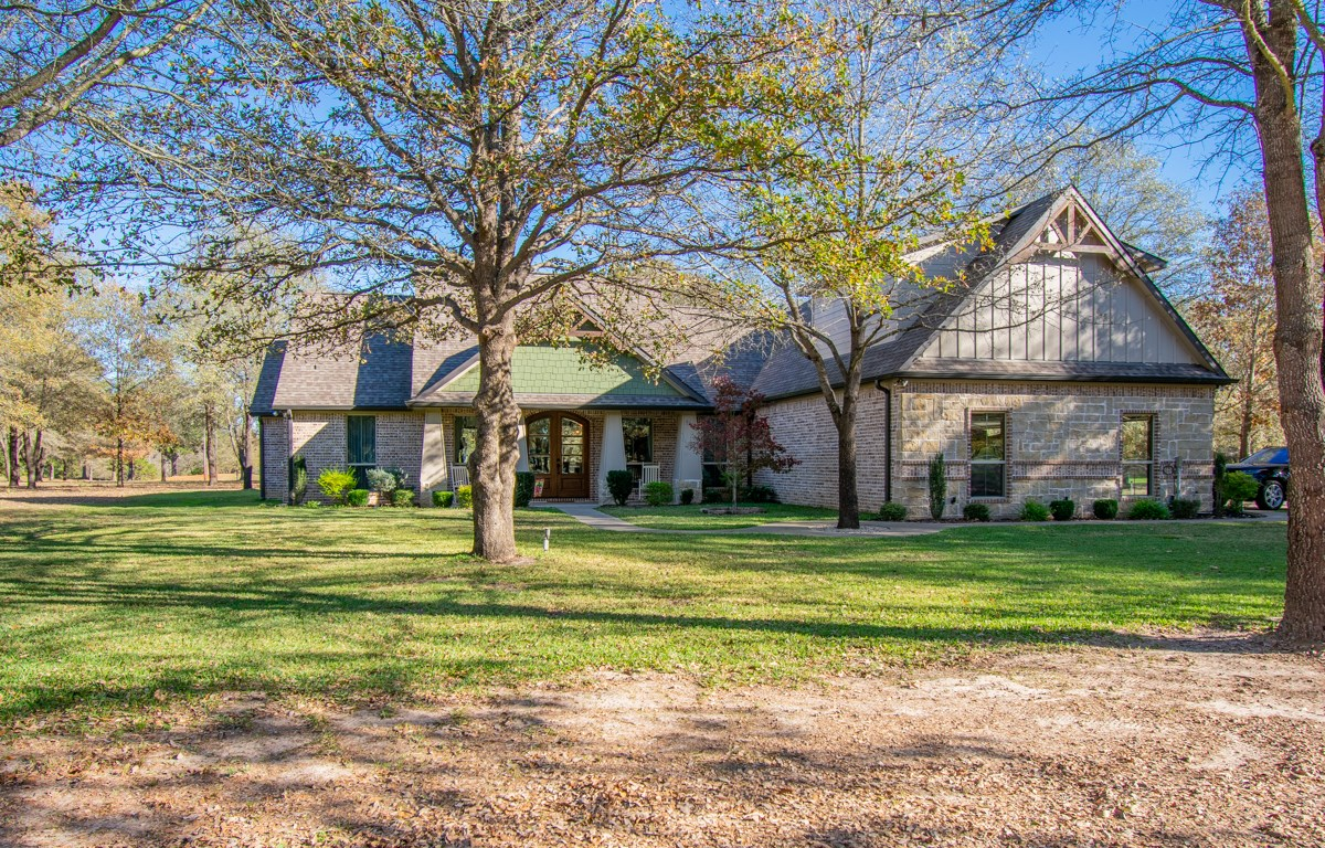 CUSTOM BUILT HOME ON GOLF COURSE WITH ACREAGE