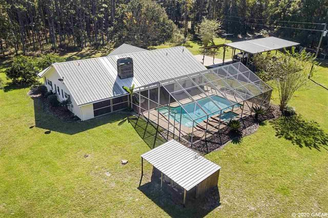 BEAUTIFUL COUNTRY HOME WITH PLENTY OF ACREAGE TO ROAM!