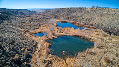 180+ acres to hunt, fish, and play in western Colorado