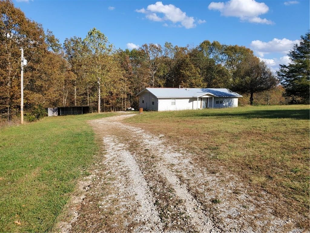 3 acres with 2000 sq foot home