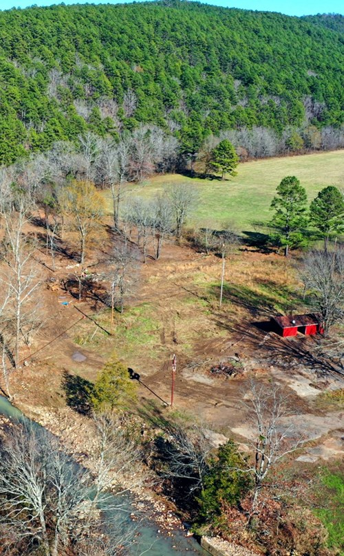 5.12 Acres M/L.,  LAND ONLY! BACKS UP TO MILL CREEK!