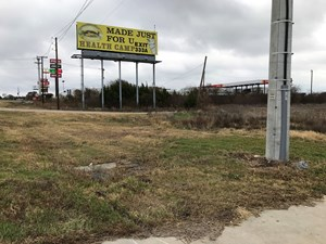 57 ACRES, IH-35 ROAD FRONTAGE 1,985 FT, ZONED C2 COMMERCIAL