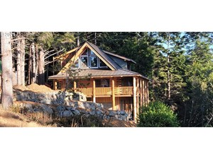LOG CABIN  WITH OCEAN VIEW PEAKS FOR SALE
