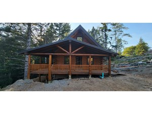 LOG CABIN ON ALMOST AN ACRE FOR SALE