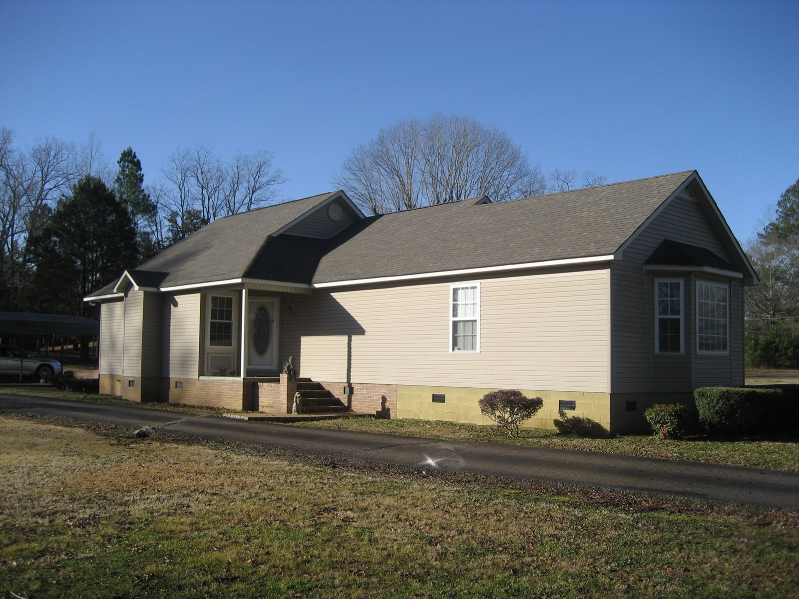 HOME FOR SALE IN ADAMSVILLE, TN WITH SHOP & POND