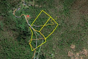 MOUNTAIN TRACT WITH HOMESITE AND LONG RANGE VIEWS