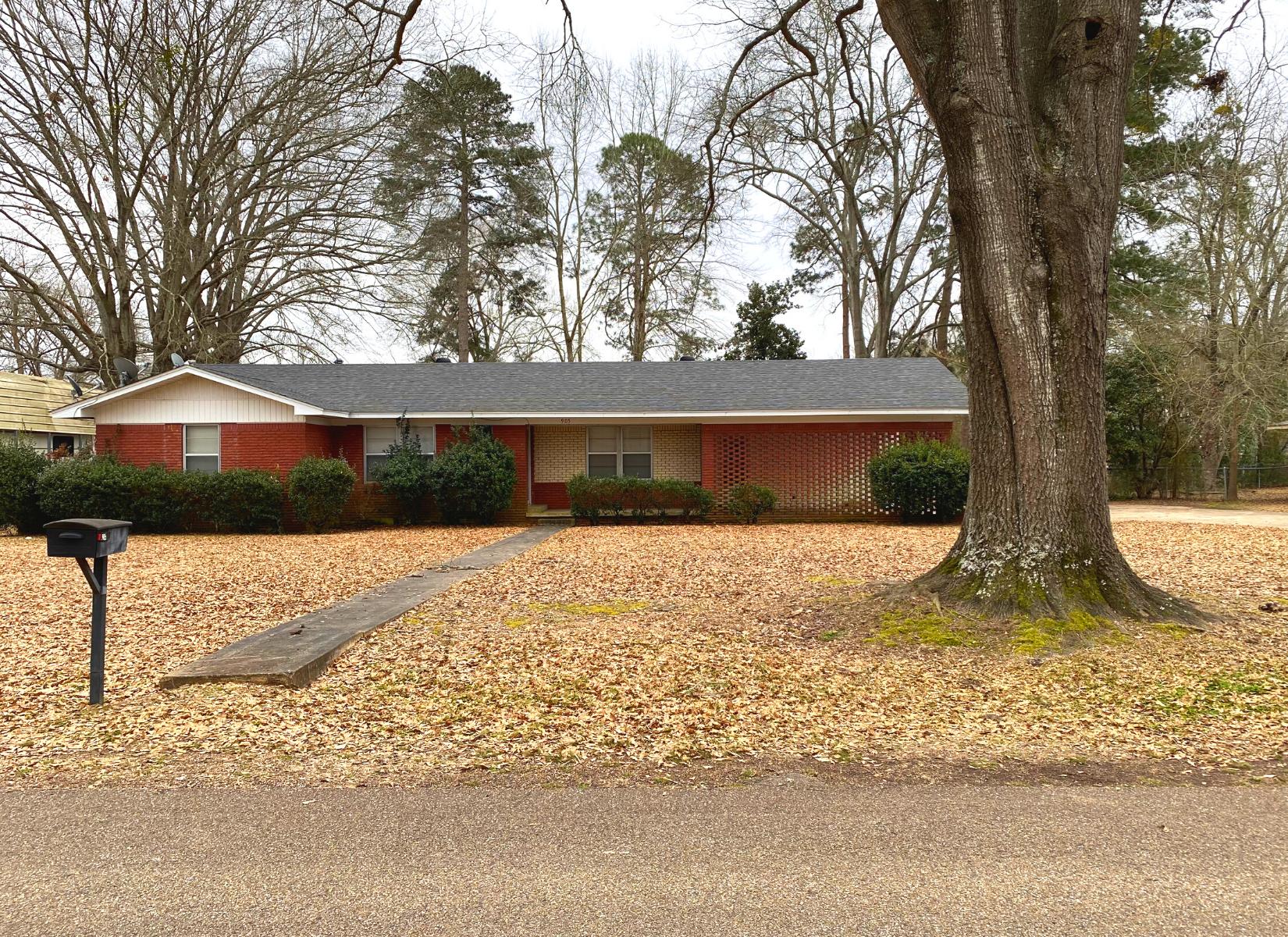 Brick home in town for sale in Atlanta, Texas