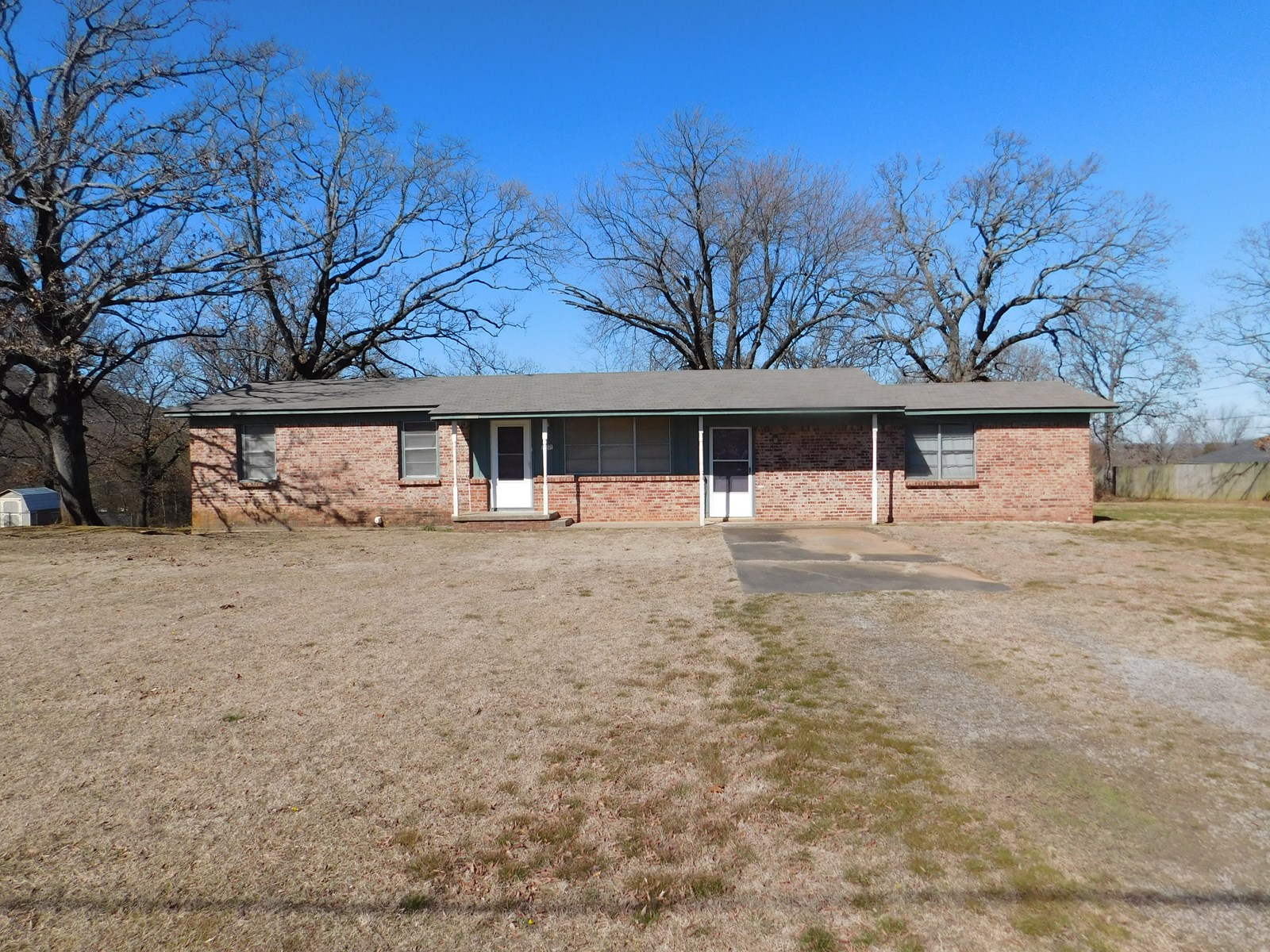 HOME IN TOWN ON ACREAGE-POTEAU, OK