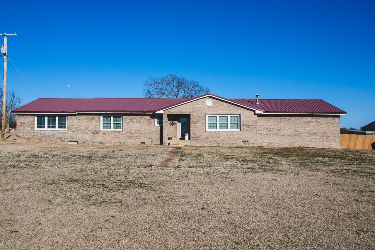 Large Home on 10 acres near town with a pond and shop