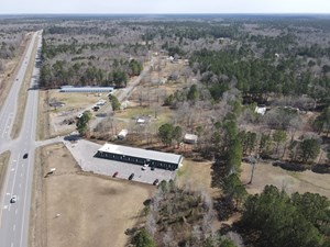 BUSINESS FOR SALE WITH HIGHWAY FRONTAGE AND ACREAGE IN AR
