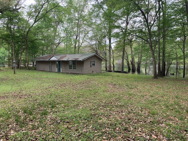SANTA FE RIVER FRONT LOT AND HOME FOR $185,000!!
