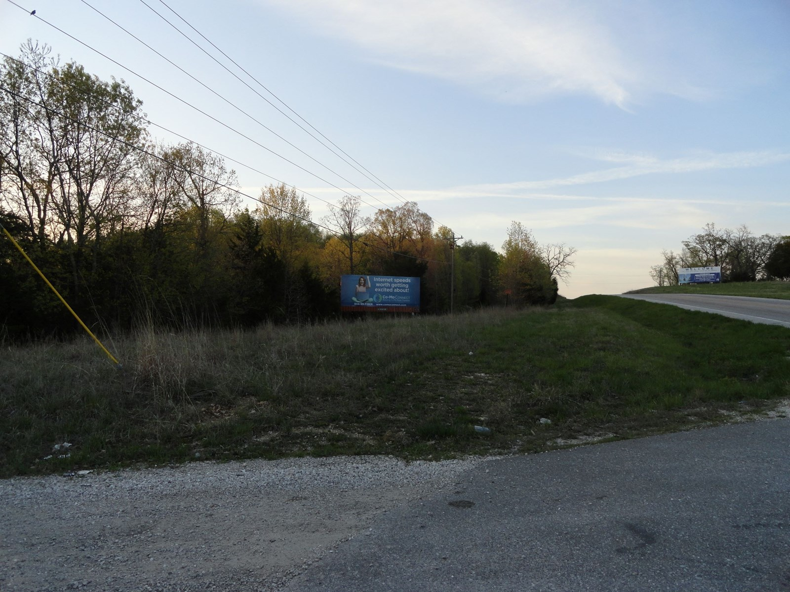Land with home for sale on Hwy 5 in Sunrise Beach, MO