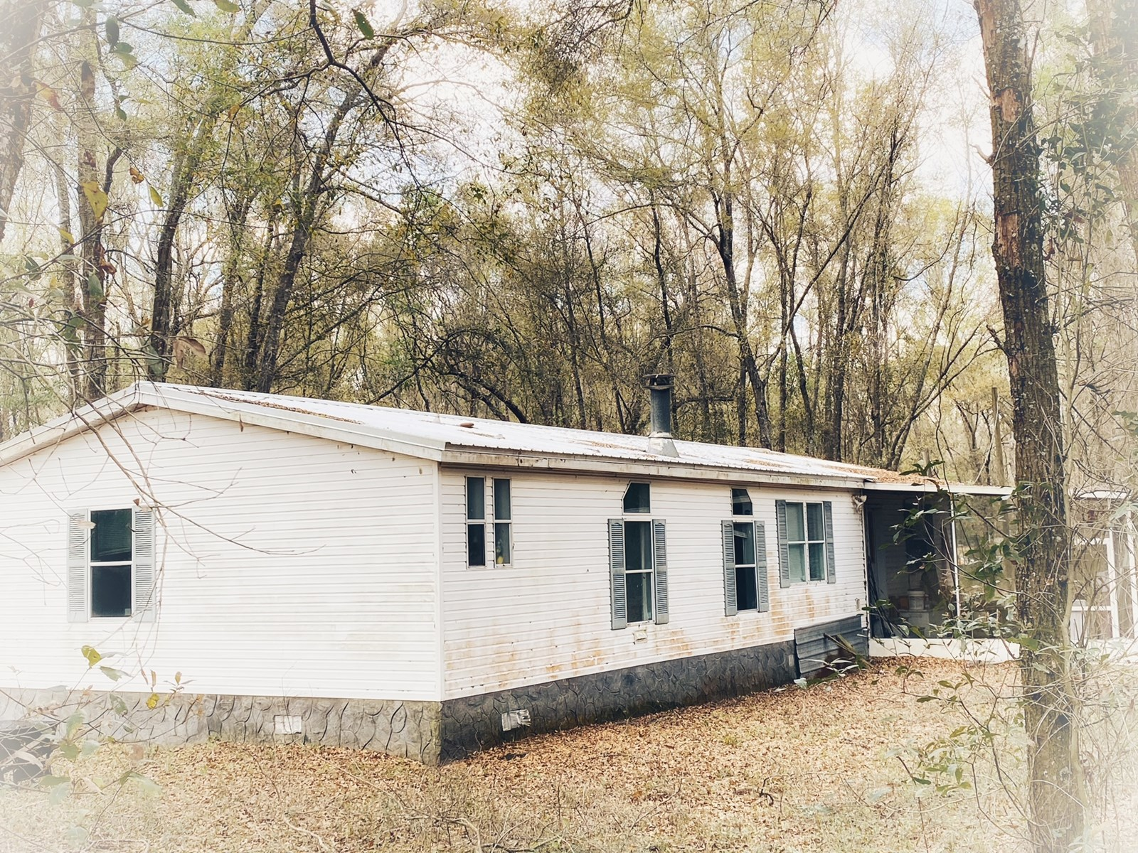 HUGE DOUBLE WIDE MOBILE HOME ON 11.74 ACRES FOR ONLY $99,999