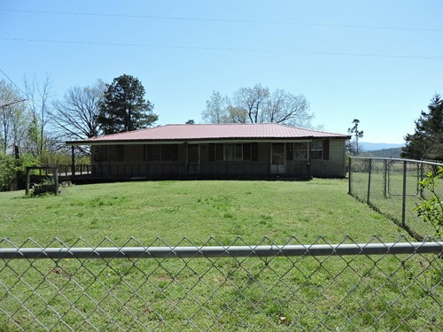 FIXER- UPPER HOUSE ON 4 ACRES M/L!