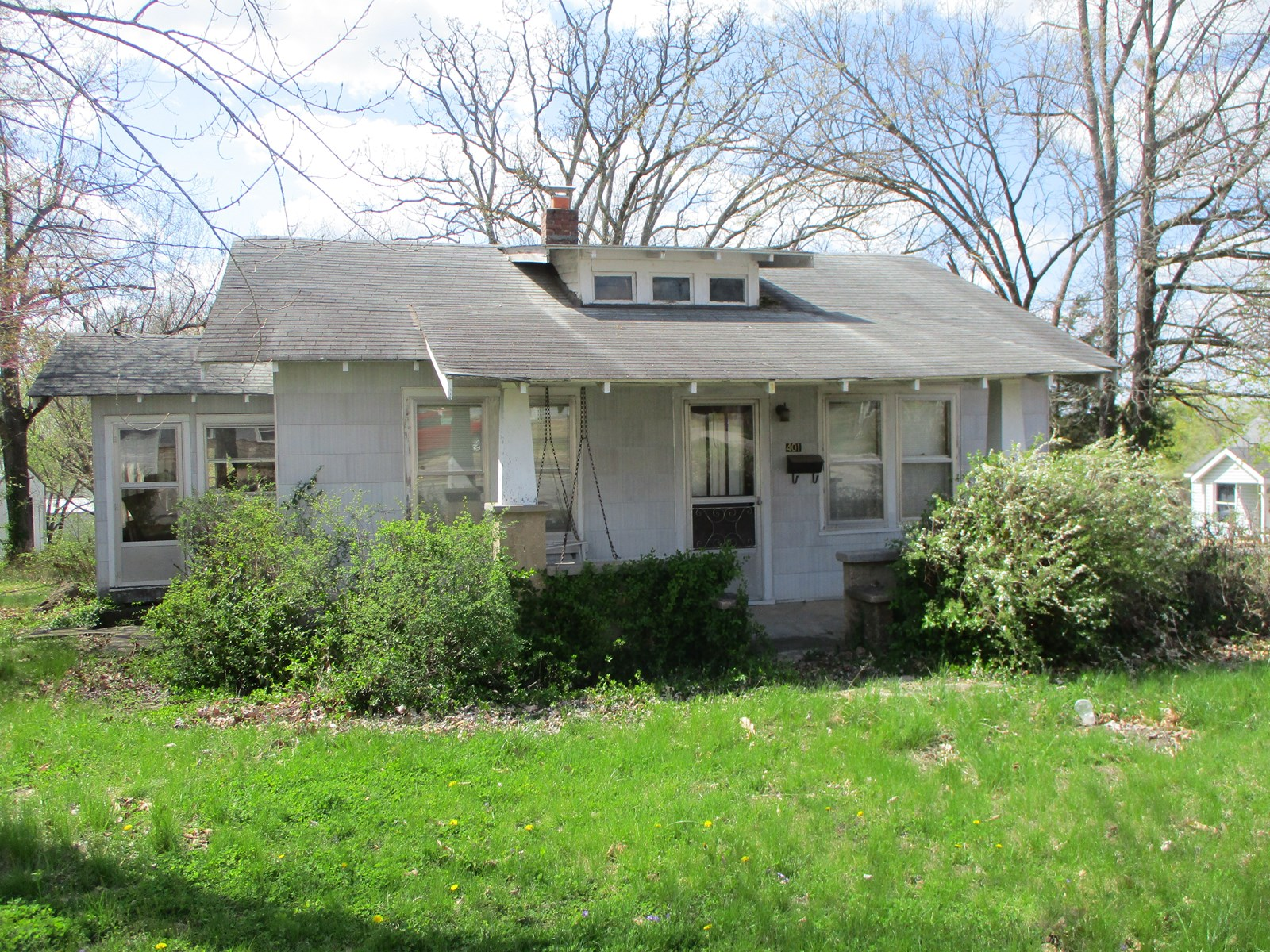 Fixer Upper Home or Investment Opportunity with Large Lot!