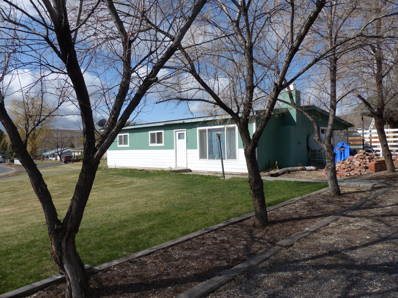 NICE HOME ON OVER 1/2 ACRE WITH SHOP!