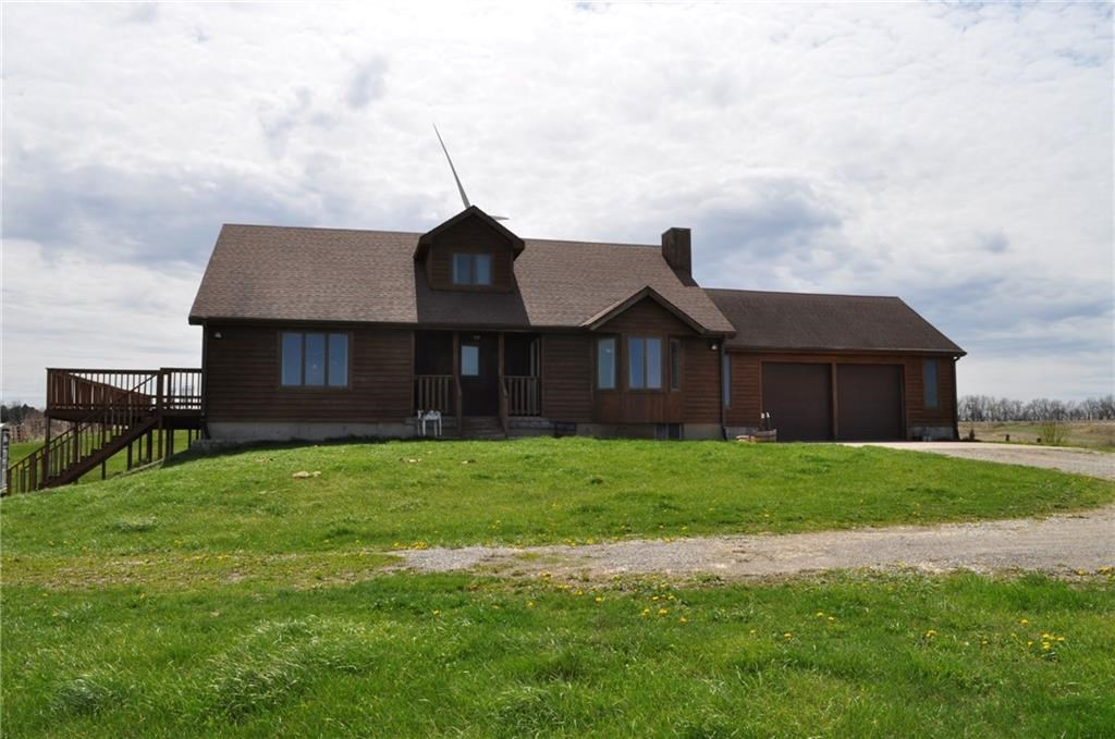 Beautiful cedar sided country home setting on 6.5 acres!