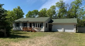 HOME FOR SALE ON CANADA CREEK RANCH IN ALTANTA MI