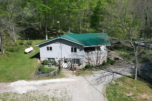 FARM FOR SALE IN TN. WITH 3 HOMES, SHOPS , SPRINGS,  HUNTING