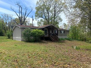 END OF ROAD LAKE HOME AND ACREAGE