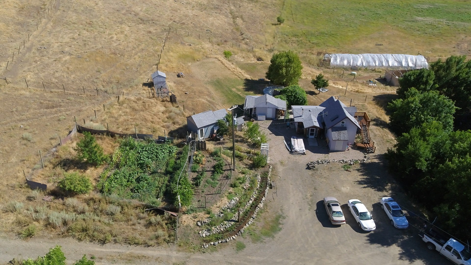 A Cozy Home w/ Farm Animals and a Shop on 16+ Acres of Land