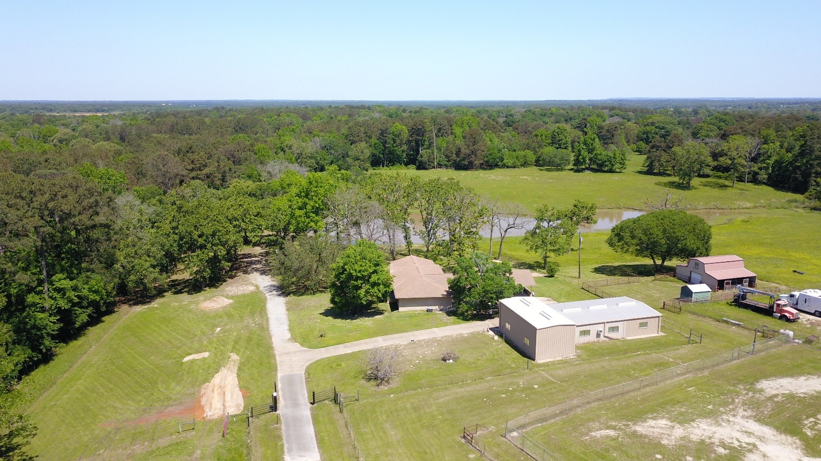 COUNTRY HOME & ACREAGE WITH POND FOR SALE IN EAST TX