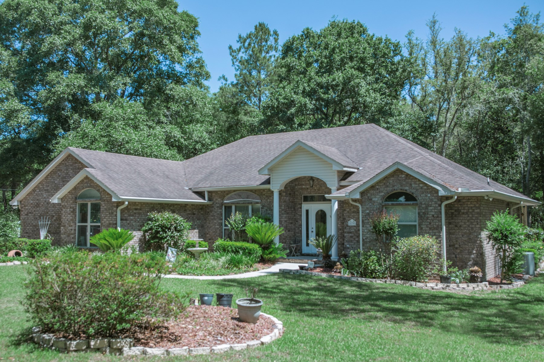 North Florida, 12.27 Acres with woods, brick home and creek