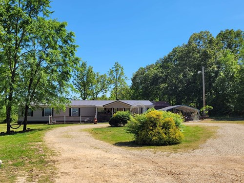 Beautiful Home and shop on 7+/- Acres In Southeast Missouri