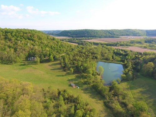 Country Home, large spring fed pond on 38.98 acres for sale