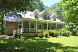 HOME ON 48 WOODED ACRES WITH POND AND HORSE BARN SW MS