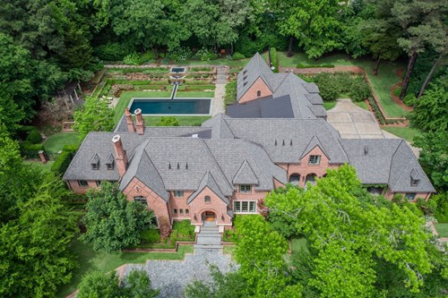 EXQUISITE ENGLISH TUDOR HOME IN GATED COMMUNITY