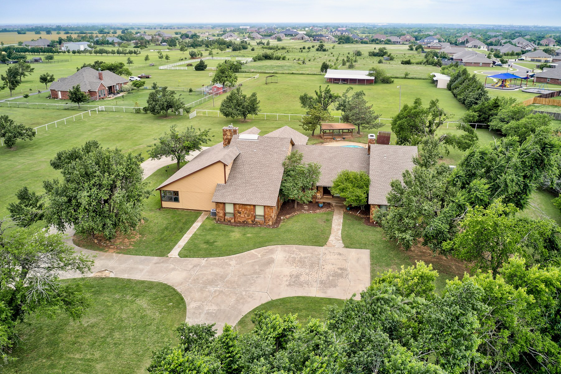 10+ Acres in Town - Large Home with Pool!
