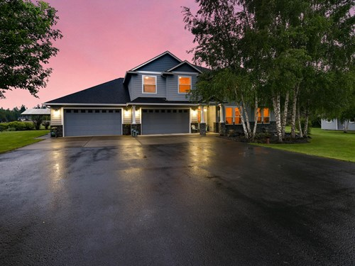 Stunning custom-built home on 5 pristine acres in La Center,