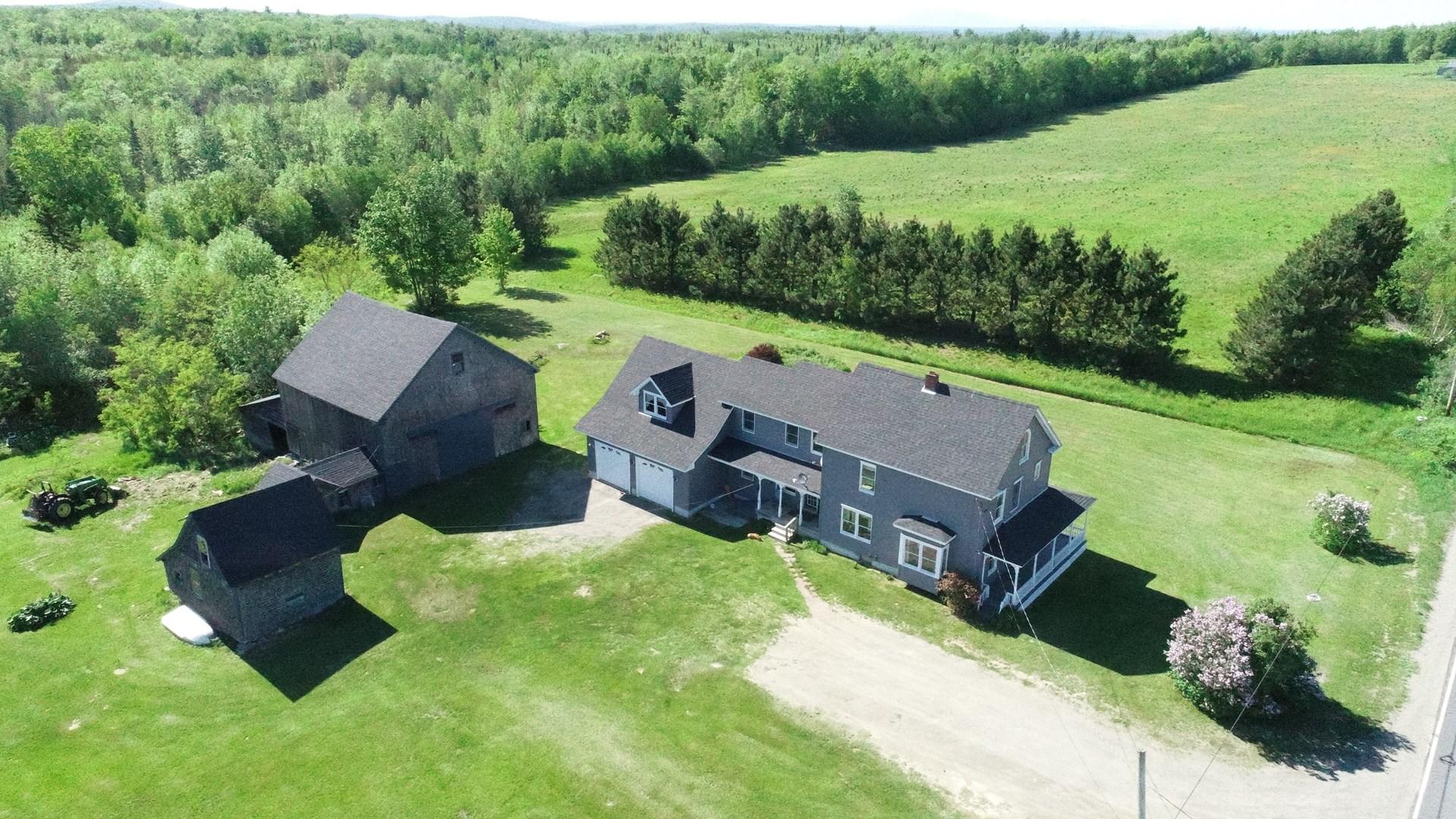 Maine Farmhouse for sale with acreage