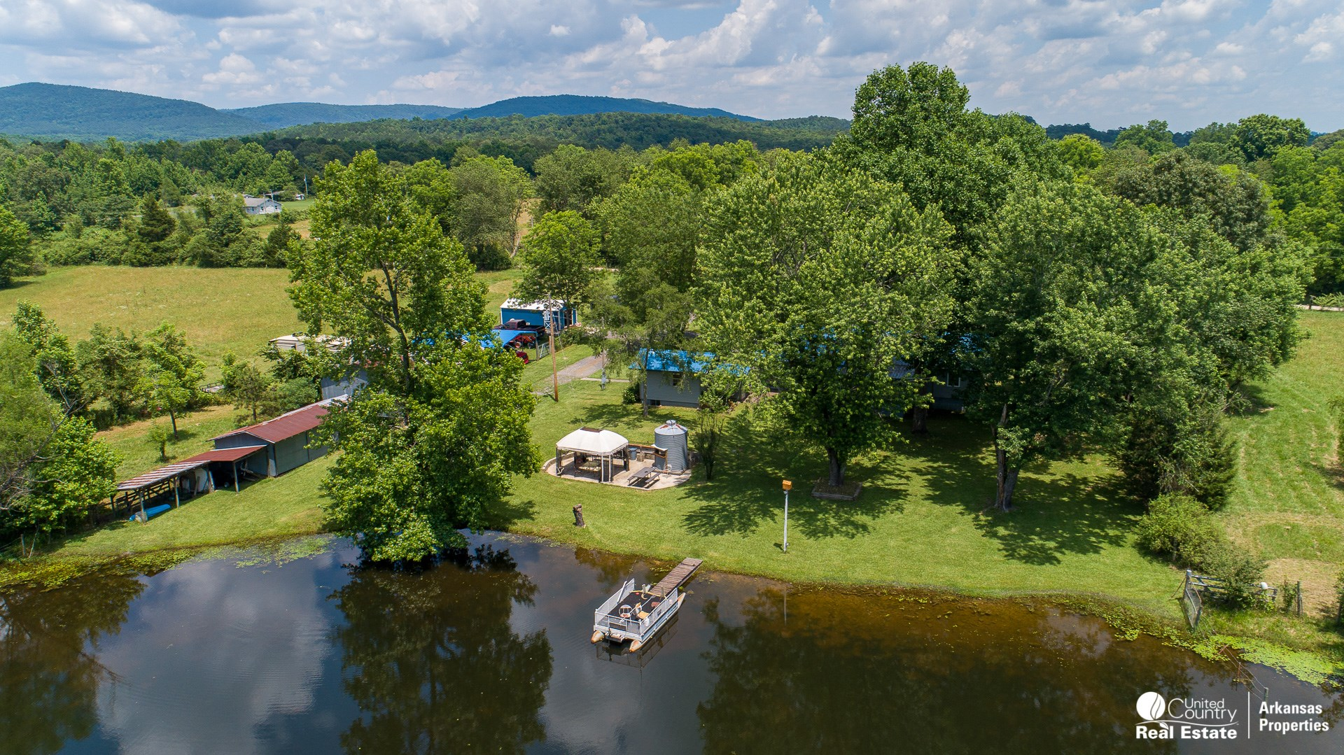 Country Home with acreage for sale in Arkansas with pond.
