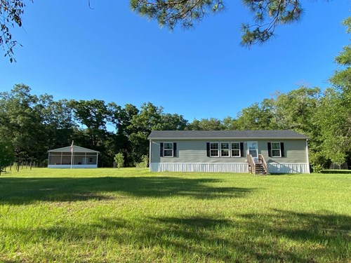 BEAUTIFUL MOBILE HOME ON 15 ACRES!